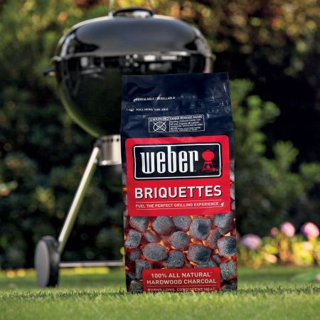 A Bag Of Weber Charcoal Hardwood Briquettes Shown With A Weber Charcoal Grill