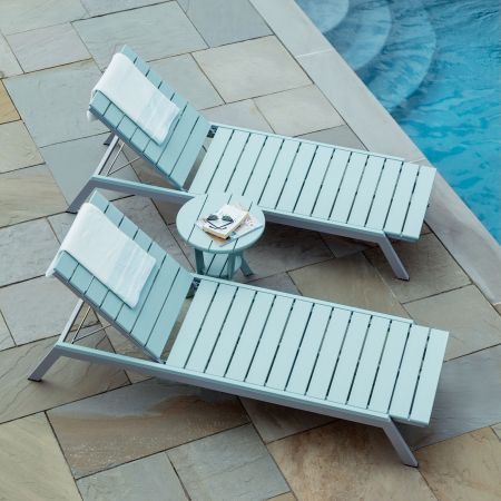 A Pair Of Seaside Casual Sage Mad Fusion Chaise Lounges Shown With A Side Table