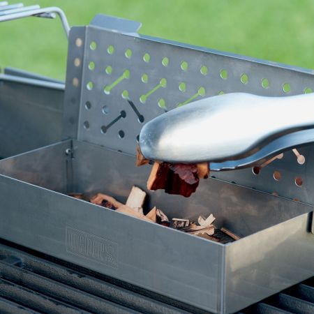 Adding Wood Chips Into The Weber Smoker Box