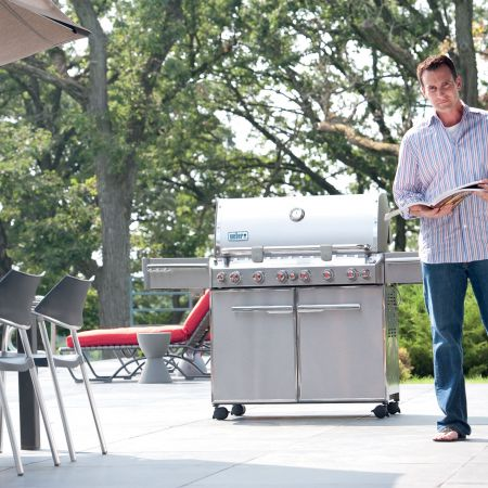 Choosing The Next Great Recipe To Prepare On His Weber Summit Gas Grill
