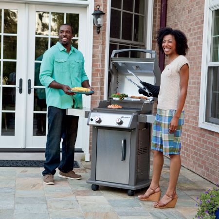 Couple Grilling On The Weber Spirit S-210 Gas Grill2