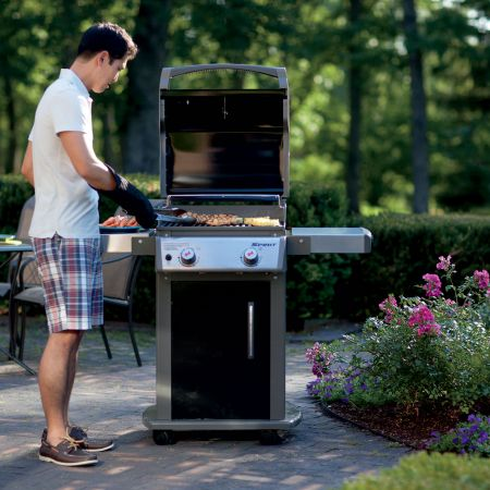 Guy Grilling On His Weber Spirit E-210 Gas Grill