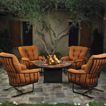 Monterra Spring Base Lounge Chair Shown with Fire Pit and Swivel Rocker Lounge Chair