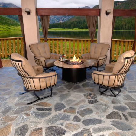 Monterra Swivel Rocker Lounge Chair Shown with Fire Pit and Spring Base Lounge Chair