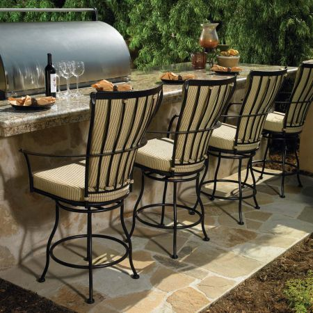 Monterra Swivel Stool Shown up to Barbecue Island