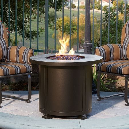 OW Lee Casual Fireside 30 Round Santorini Chat Fire Pit Shown with Spring Base Chairs