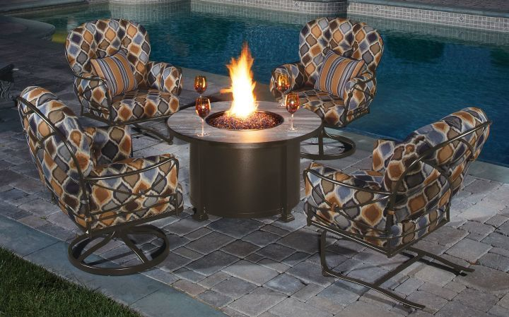 OW Lee Casual Fireside 42 Round Santorini Chat Fire Pit Shown with Lounge Chairs