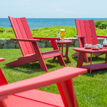 Seaside Casual Mad Fusion Cherry Adirondack Chairs Shown With A Coffee And Side Table