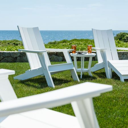 Seaside Casual Mad Fusion White Adirondack Chairs Shown With An Ottoman And Side Table