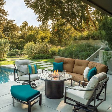 Tropitone Kenzo Cushion Cresent Sofa, Cresent Love Seat, Swivel Action Lounge Chair, and Cresent Ottoman Shown with Banchetto 42 Round Fire Pit