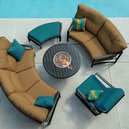 Tropitone Kenzo Cushion Cresent Sofa, Cresent Love Seat, Swivel Action Lounge Chair, and Cresent Ottoman Shown with Banchetto 42 Round Fire Pit Aerial View