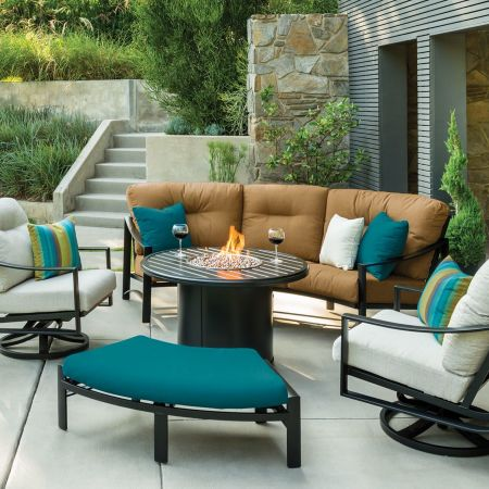 Tropitone Kenzo Cushion Cresent Sofa, Cresent, Pair of Swivel Action Lounge Chairs, and Cresent Ottoman Shown with Banchetto 42 Round Fire Pit