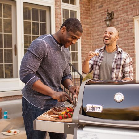 Friends Grilling On The Weber Spirit E-210 Gas Grill