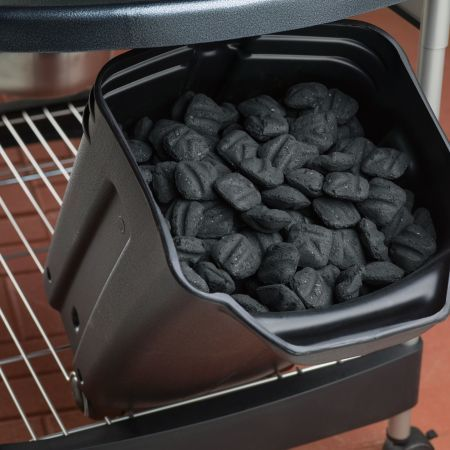 Weber Performer Deluxe Charcoal Grill Close Up of Filled Charcoal Bin (Charcoal Sold Separately)